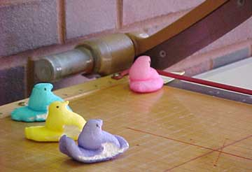 photo of Peeps using paper cutter