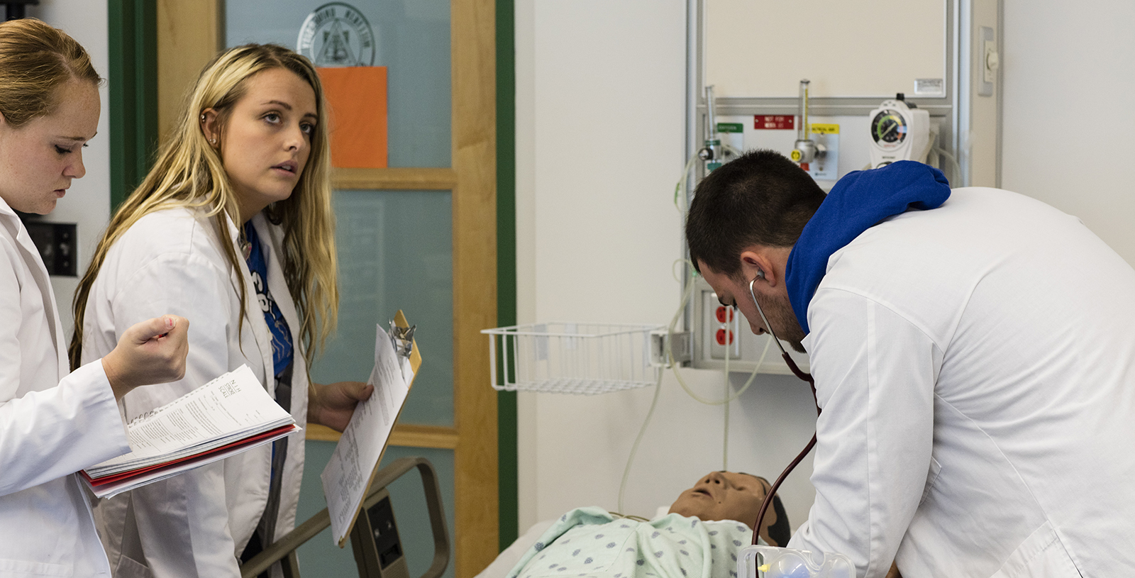 Students conducting nursing simulation