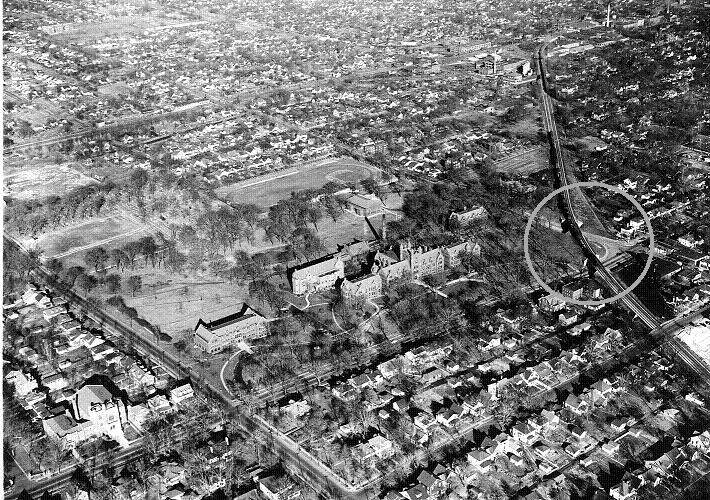 Aerial view of Millikin campus with gray circle overlay (late 1930s)