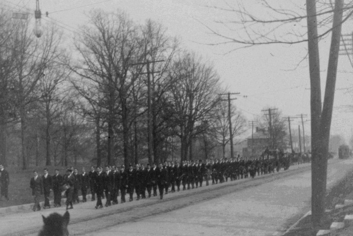 Photograph of James Millikin's body being escorted by students up West Main Street to Millikin University in 1909