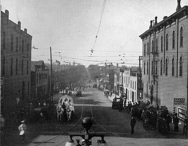 1916 Millidek image of parade up West Main St.