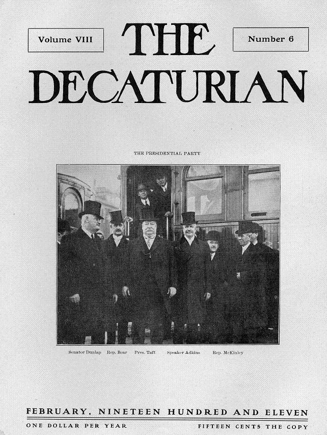 Cover of February 1911 Decaturian showing President and party posed in front of ITS train in front of Millikin University