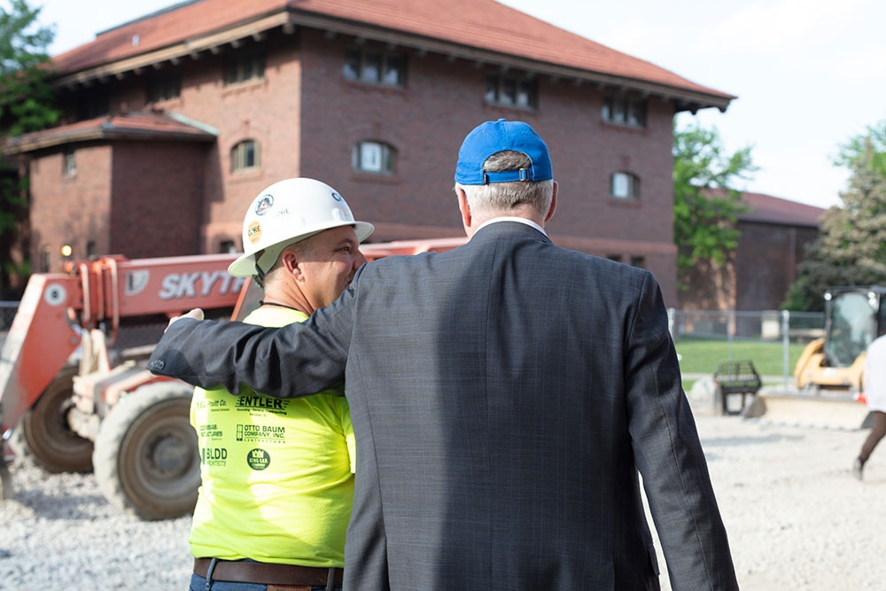 President White and worker at the CfTaD construction