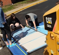 Millikin students create prints using steamroller
