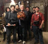 "Zachary Cook, Instructor Hector, and Gary Busey pose with additional cast and crew on the set of ""Trick and Treats."""